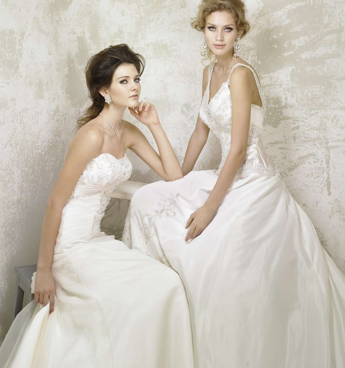 Photograph of two models wearing wedding gowns, by AsiaPhoto photographer Lance Lee.