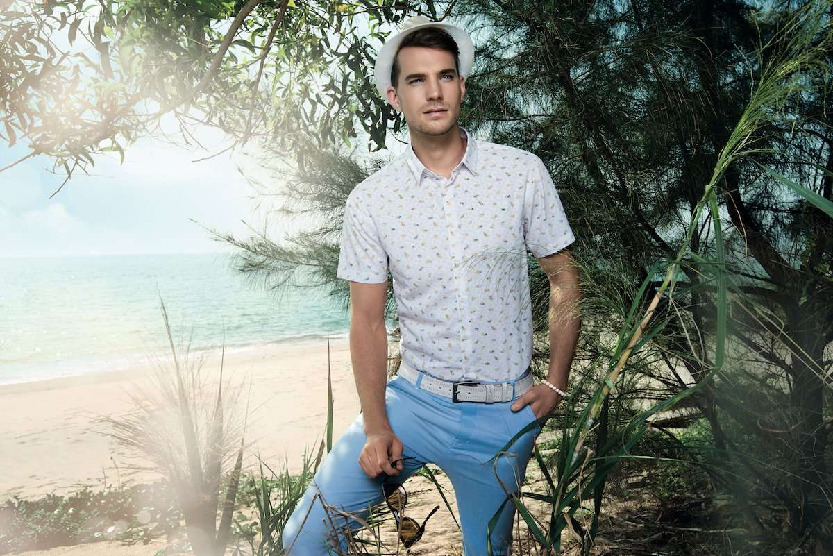 Photograph of a male model under a tree, wearing clothing by AWAN brand, by photographer Lance Lee.
