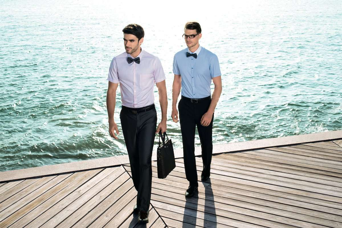 Photograph of two male models on a pier, wearing clothing by AWAN brand, by photographer Lance Lee.