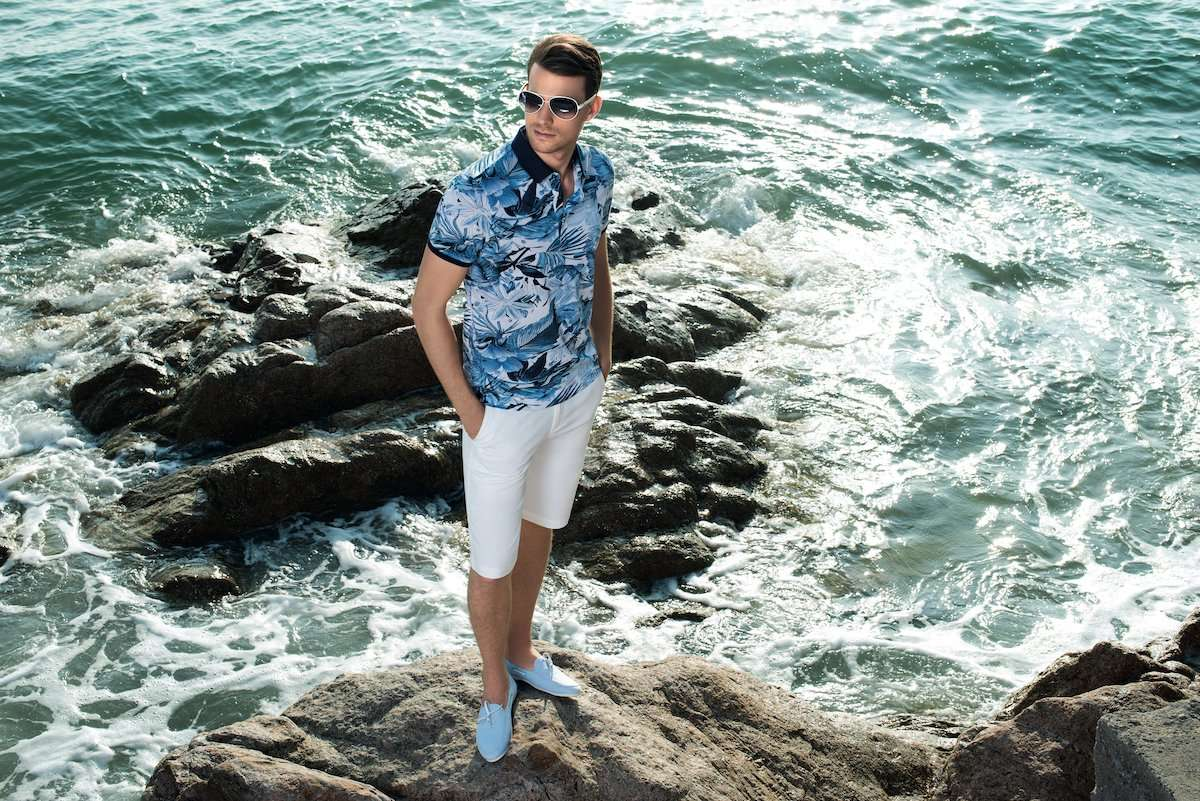 Photograph of a male model at a beach, wearing clothing by AWAN brand, by photographer Lance Lee.
