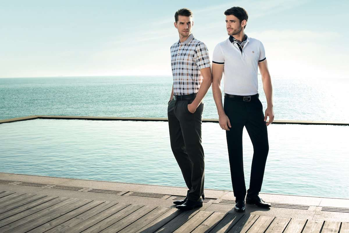 Photograph of two male models at a pool, wearing clothing by AWAN brand, by photographer Lance Lee.