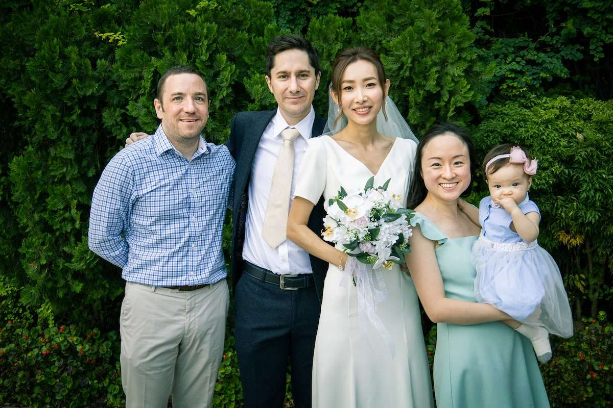 Photograph of newlywed couple with wedding guests, by AsiaPhoto photographer Lance Lee.