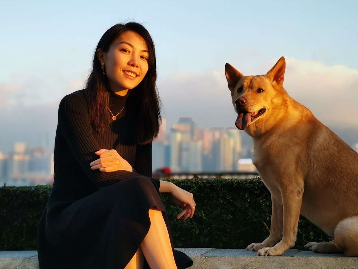 Photograph of girl with a dog at sunset, by AsiaPhoto photographer Lance Lee.