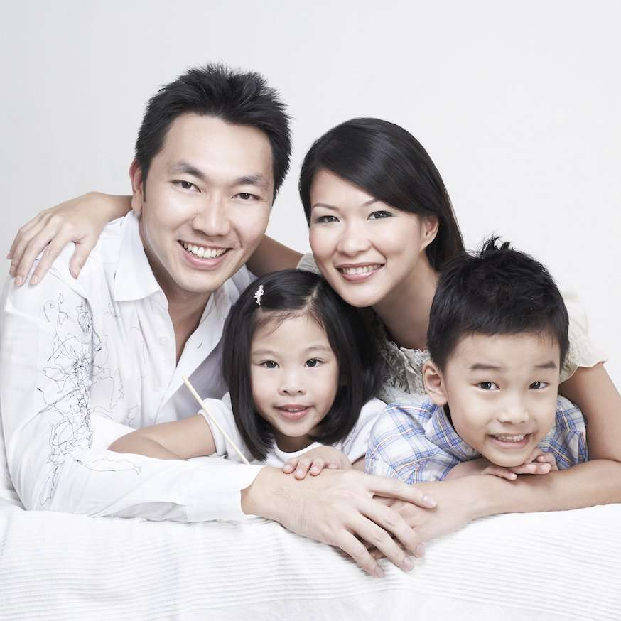 Family photography session on bed